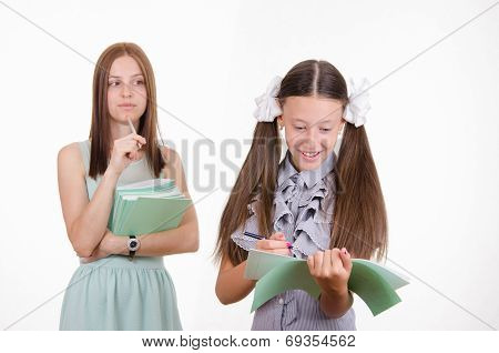 The Teacher Looks At The Student With A Notebook