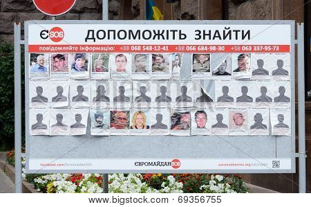 Poster with photos of missing people saying