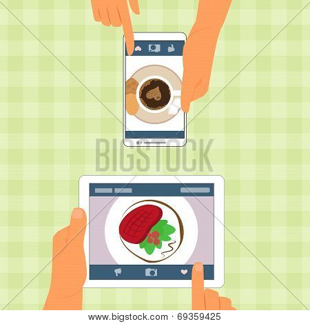 Man and woman and their food placed on gadgets