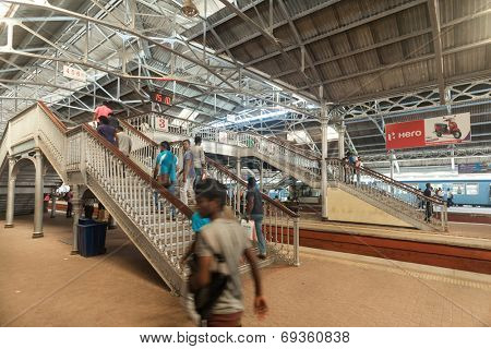 HIKKADUWA, SRI LANKA - FEBRUARY 22, 2014: Passengers at Colombo train station. Taking the train is a great way to get around Sri Lanka, as it's cheap, safe and part of the experience.