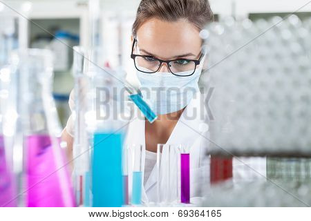 Woman Analyzing Liquid In Test Tube
