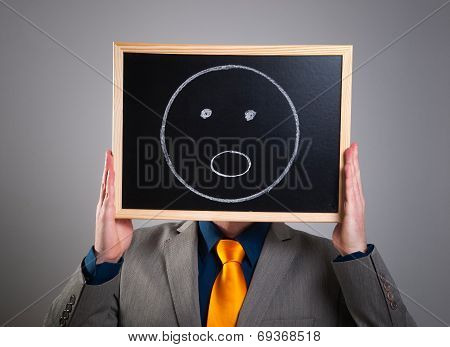 Businessman Hiding His Face With A White Billboard With A Surprised Face