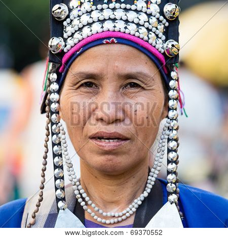 Unidentified Akha Indigenous Hill Tribe Woman In Traditional Clothes Sells Souvenirs , Thailand