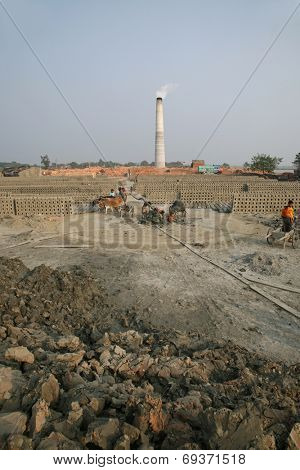 SARBERIA,INDIA, JANUARY 14: A Brickfield is a large landed area, used for manufacturing bricks. Tools and machines for making bricks are very rudimentary, Jan 14, 2009 in Sarberia, West Bengal, India.