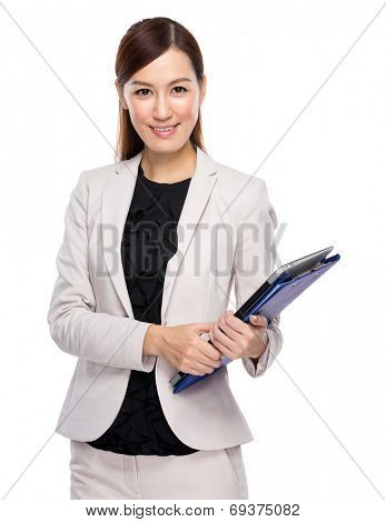 Businesswoman hold clipboard and laptop