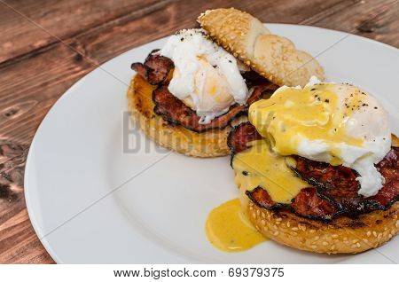 Benedict Eggs With Crispy Bacon And Hollandaise Sauce On Toasted Maffin
