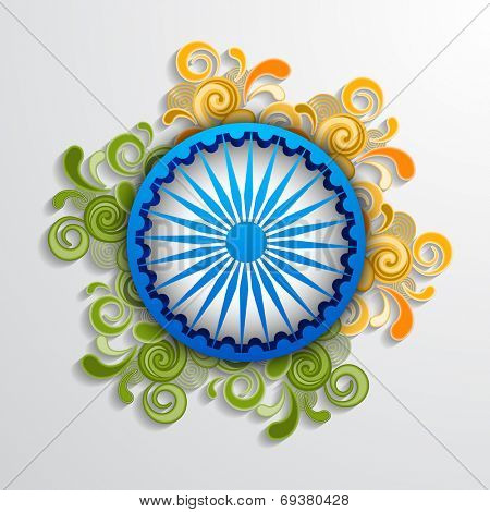 Blue Asoka Wheel decorated with floral design in saffron and green color on grey background for 15th of August, Indian Independence Day celebrations.