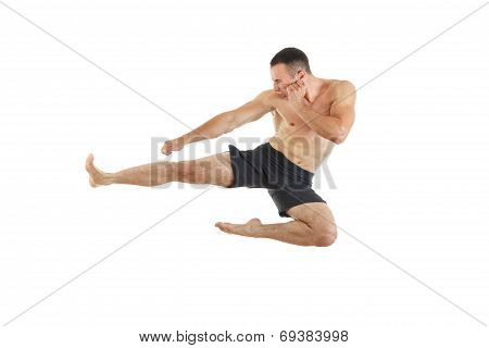 Athletic Boxer Fighter Performing A Flying Side Kick