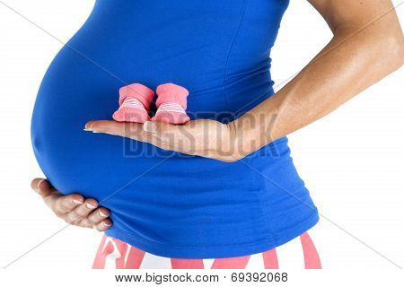 Pregnant Model Holding Pink Girl Booties Close Up