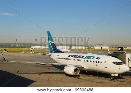 WestJet aircraft at the gate at Calgary International Airport