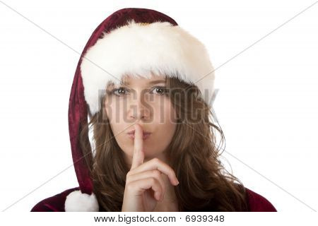 Santa Claus Woman With Christmas Fur Holds Finger On Mouth