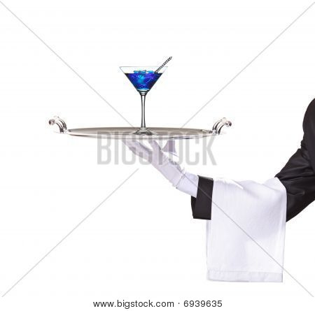 A butler holding a tray with cocktail blue curacao on it