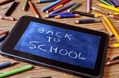 stock photo of year end sale  - a tablet with a picture of a chalkboard with the sentence back to school written in it - JPG