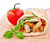 stock photo of sandwich wrap  - Wrap sandwich Moroccan style with couscous chicken tomatoes and basil - JPG