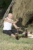 picture of scythe  - Senior farmer using scythe to mow the lawn traditionally - JPG