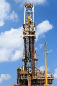 image of derrick  - Derrick of Tender Drilling Oil Rig  - JPG
