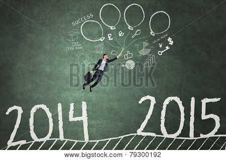 Employee Flying Over The Number 2014 To 2015