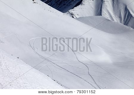 View On Snowy Off Piste Slope With Trace From Ski And Snowboards
