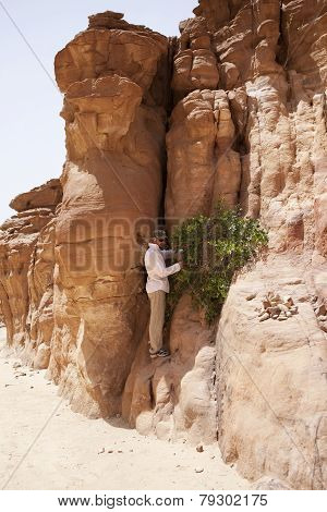Tourist in the Colored Canyon. Mountains of Sinai. Egypt.