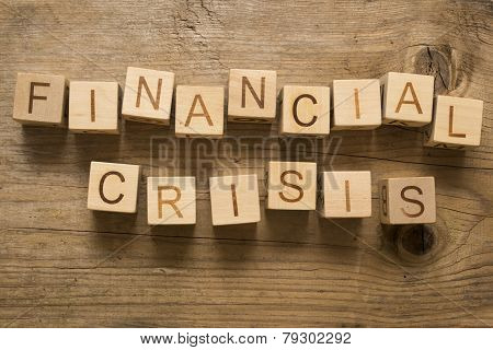 Financial crisis text on a wooden blocks
