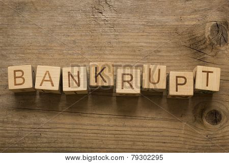bankrupt text on a wooden blocks on a wooden background