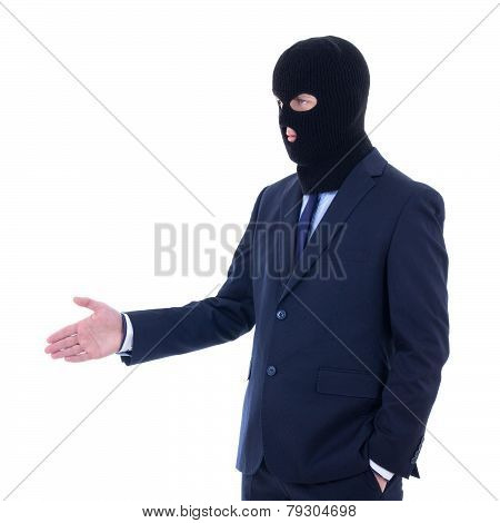Corruption Concept - Man In Business Suit And Black Mask With Hand Extended To Handshake Isolated On