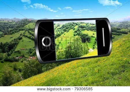 Smart phone and rural landscape