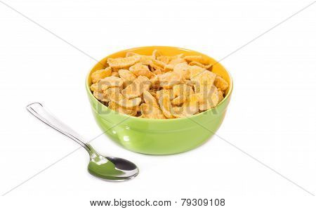 Bowl of corn flakes with spoon.