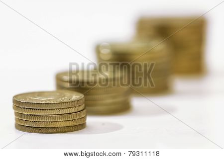 Money Growth Concept, Where Small Coins In A Pile Gets Bigger And Higher For Each Pile.
