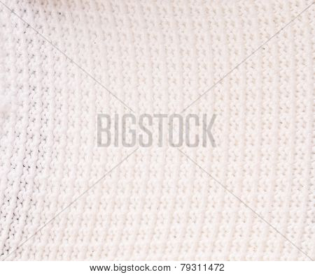 Background of knitted fabric texture. Close up.