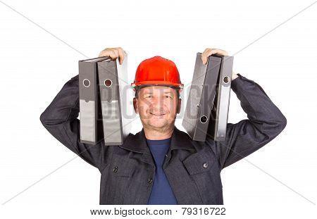 Man in coat holding folders.