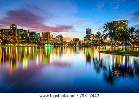 Orlando, Florida, USA downtown city skyline on Eola Lake.
