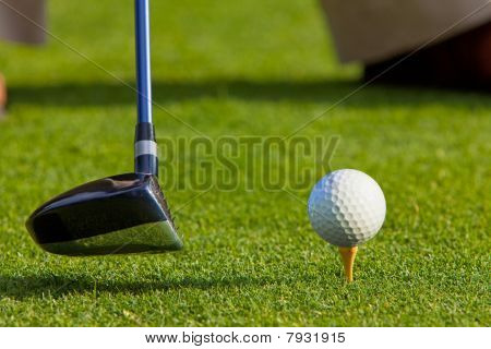 Golfer getting ready to hit ball off the tee