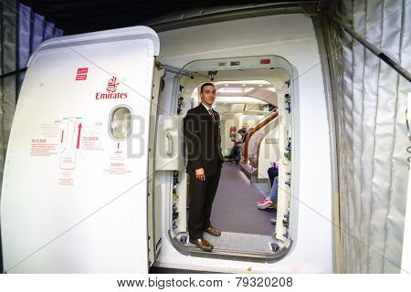 DUBAI - OCT 17: Emirates crew member meet passengers in Airbus A380 aircraft on October 17, 2014 in Dubai, UAE. Emirates handles major part of passenger traffic and aircraft movements at the airport.