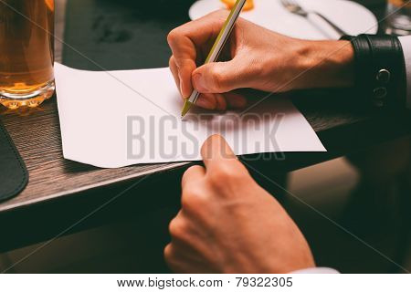 Hand Writing On Sheet In Night Club