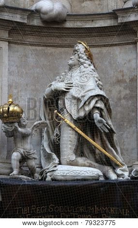 VIENNA, AUSTRIA - OCTOBER 10: Statue of Emperor Leopold praying, Plague Monument in Vienna, Austria on October 10, 2014.