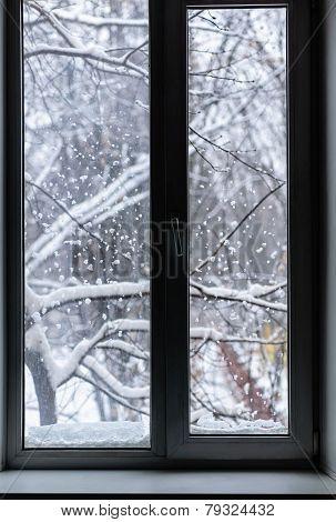 Snowfall Outside The Window