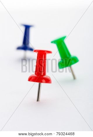 Push-pins close-up isolated on white background