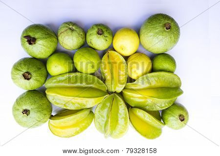 closeup of a fruits ~ starfruit, lemon, guava on a solid background