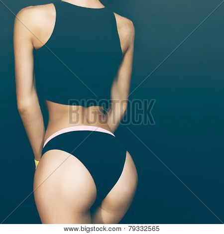 Buttocks Sexy Girl Athlete On A Black Background