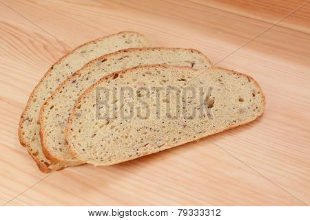 Three Slices Of Bread On A Wooden Table