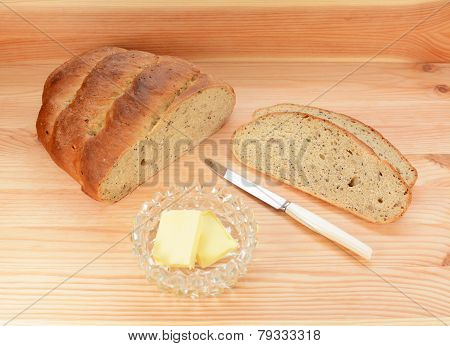 Slices Of Fresh Bread With Pats Of Butter