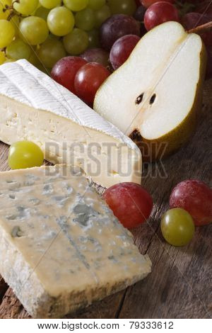 Cheese With Grapes And Pears Close-up. Vertical