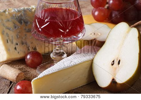 Red Wine With Cheese And Fruit Close-up Horizontal