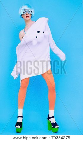 Funny Fashion Girl In Hoodie And Colored Tights On A Blue Background