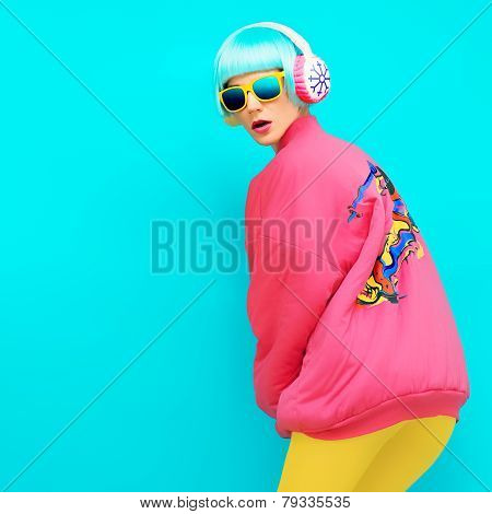 Sports Girl Winter Style On A Blue Background In Bright Vintage Hoodie And Exclusive Headphones