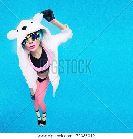 Funny Party Girl In Hoodie Bear On A Blue Background. Bright Winter Time