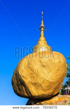 Golden rock or Kyaiktiyo pagoda with blue sky background, Myanmar