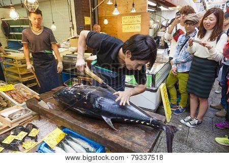 Cutting A Giant Tuna In Kuromon Market In Osaka, Japan