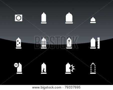 Condom icons on black background.